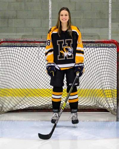 Lindsey Orlando has seen huge improvement throughout her career as a hockey player for the Tigers. This year, Lindsey has scored four goals to with seven assists, while leading her squad as a senior captain. Photo courtesy of Lindsey Orlando