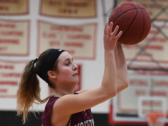 Senior Laura Petrafesa and the North Haven girls' basketball team defeated Lyman Hall in the first round of states and then lost to St. Paul in their next contest. File photo by Kelley Fryer/The Courier
