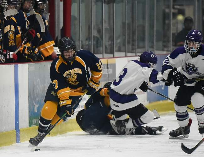 Old Saybrook junior Cory Benni lit the lamp with regularity to help the East Haven-Old Lyme-Old Saybrook-Morgan-Valley Regional-East Hampton boys' ice hockey squad make states this winter. File photo by Kelley Fryer/Harbor News