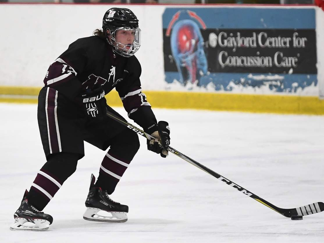 Senior captain defenseman Donny Funaro garnered All-Conference and All-State First Team honors for the North Haven boys' ice hockey squad this year. Funaro helped the Indians enjoy a turnaround campaign that saw the team record 13 wins, including a pair of victories in the playoffs. File photo by Kelley Fryer/The Courier
