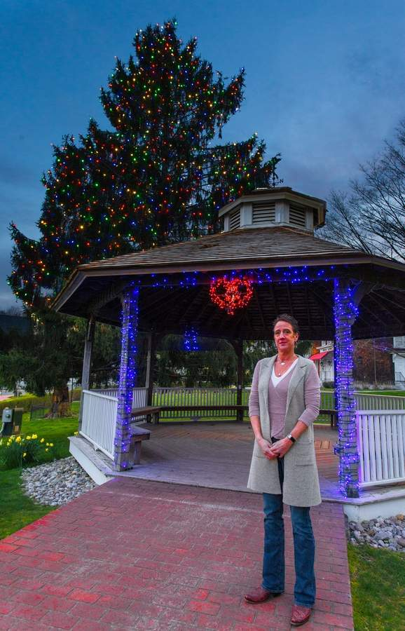 Seeing an opportunity to spread cheer in her beloved Ivoryton, Julie Hines started what became a community expression of support on the green. Photo by Jonathan Steele Photography