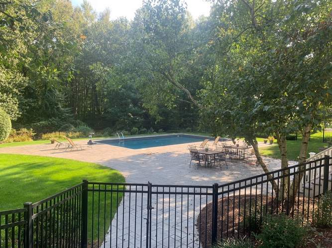 Trees around the pool provide privacy and shade.
