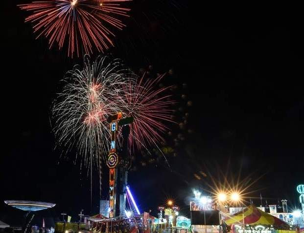 PoCo's featured fireworks display lights up the sky over the festival midway in August 2019. The festival has been canceled due to COVID-19 and will return next year.   File Photo by Kelley Fryer/The Sound