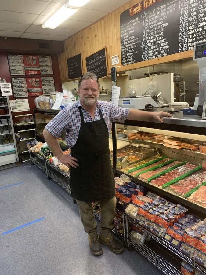 Second-generation shopkeeper Paul Kozey keeps Walt's Market on Main Street, Old Saybrook, going through good times and crises like the current pandemic.  Photo courtesy of Paul Kozey
