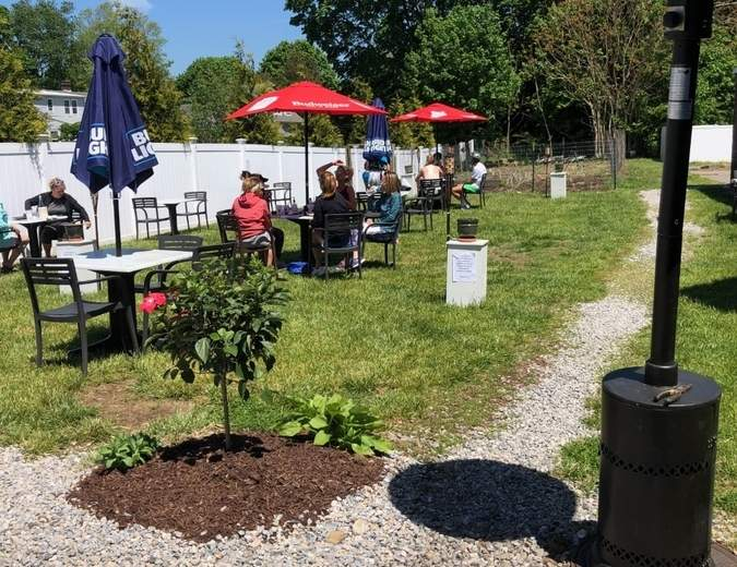 Following a scramble by town officials to streamline permit processes, restaurants like the Penny Lane Pub were able to get outdoor seating installed in time for a May 20 modified re-opening. Photo courtesy of Alex Foulkes