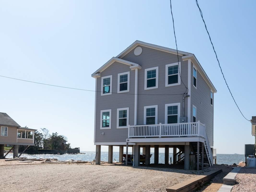 Location is everything for this home on Long Island Sound in Madison.