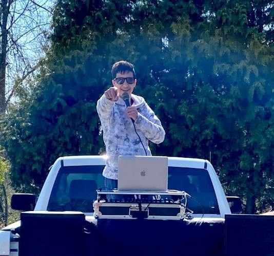 A 14-year-old DJ, Tory Teto can be spotted spinning tracks from the back of his dad's pickup as they travel through East Haven, brightening moods and raising funds for those in need of assistance or support. Photo courtesy of Chris Teto