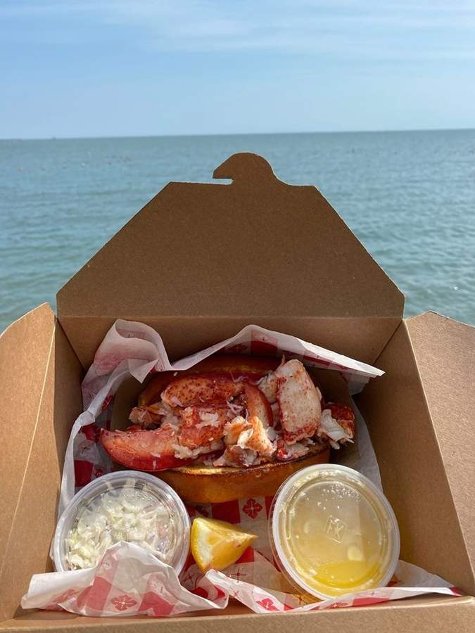 What's better than a lobster roll surfside, with a spiked seltzer? Not much, if anything. Photo courtesy of the Owenego Inn and Beach Club