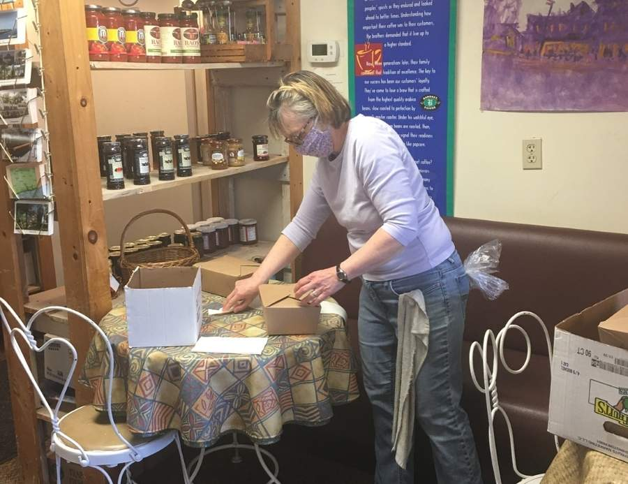 Wheatmarket owner Joan Welsh attaches notes from the Chester Rotary Club to lunches headed to Critical Care Unit staff at Middlesex Health. Photo courtesy of Francine Curto