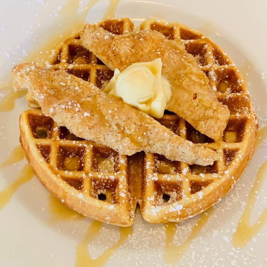 At the Tea Kettle in Old Saybrook, chicken and waffles are offered with a side of maple butter and sprinkled with powdered sugar. Photo courtesy of the Tea Kettle