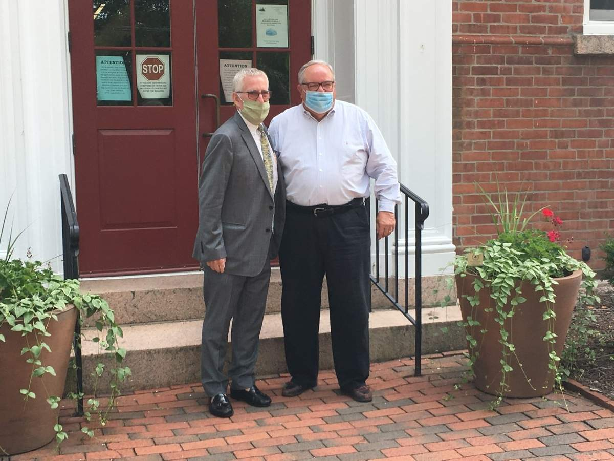 First Selectman Matt Hoey stands with Brian McGlone following a surprise July 30 motorcade farewell in front of Town Hall. Photo by Jesse Williams/The Courier