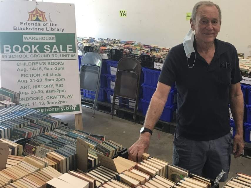 The annual tent sale was canceled due to the pandemic, but Jonathan Clark and the all-volunteer team will offer a series of Friends of the Blackstone Library Warehouse Book Sales at 59 School Ground Road, Unit 6, Branford. Photo by Pam Johnson/The Sound