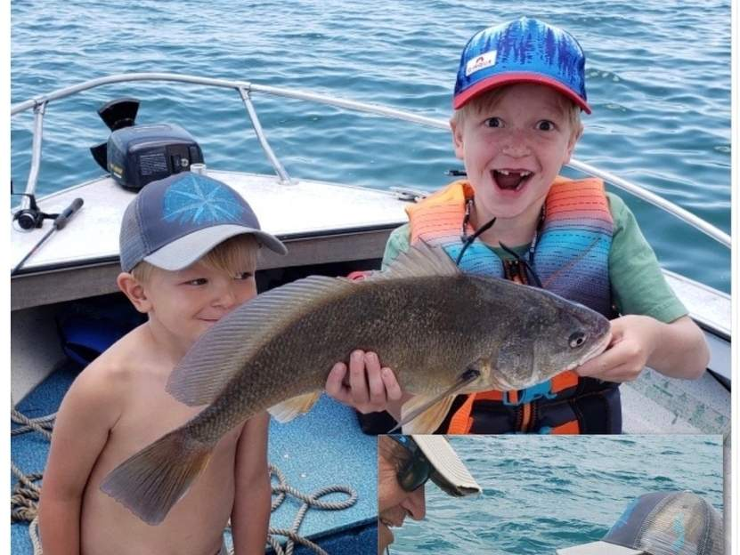 The Ford brothers—Brooks, 5, and Holden, 8—of Killingworth pair up with grandad on Lake St. Clair in Michigan to celebrate their catches of sheephead and smallmouth bass. Photo illustration courtesy of Captain Morgan