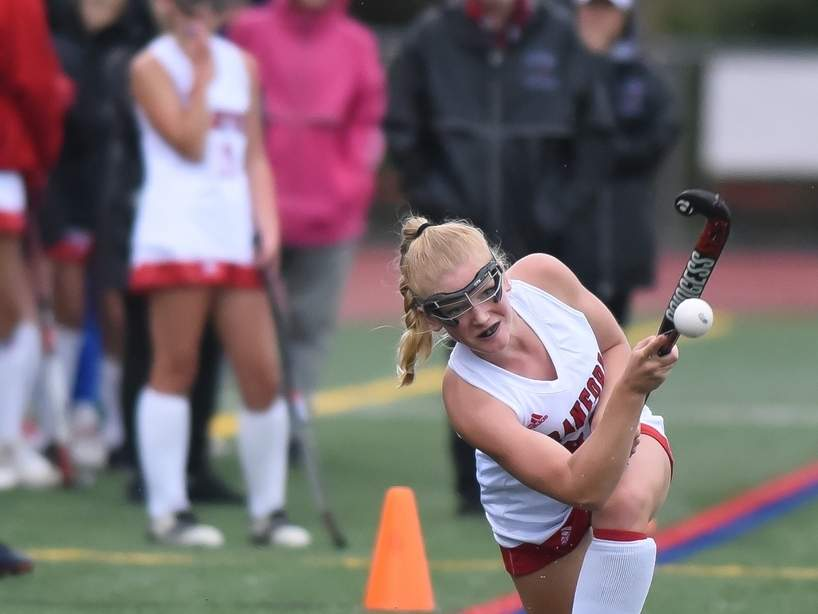 Junior Julia McHenry got to see her teammates on the Branford field hockey squad in person when the Hornets started participating in conditioning and skillwork on Aug. 29.  File photo by Kelley Fryer/The Sound