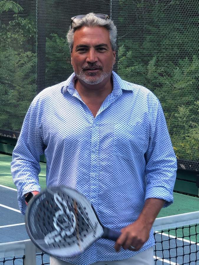 When outdoor tennis season winds down, Kevin Joyce switches gear (and strategy) by shifting to paddle tennis. Photo by Rita Christopher/Harbor News