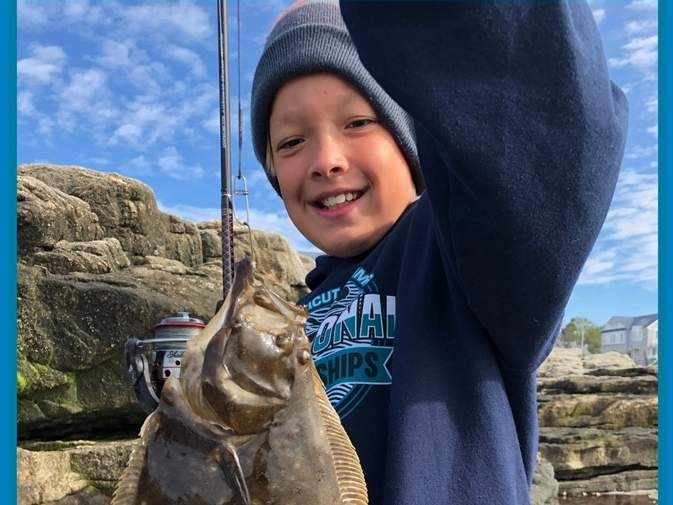 James Alvarado, 10, of Madison caught his first flounder in the midst of tangled lines and a dismayed group of fishless adults. Photo courtesy of Captain Morgan