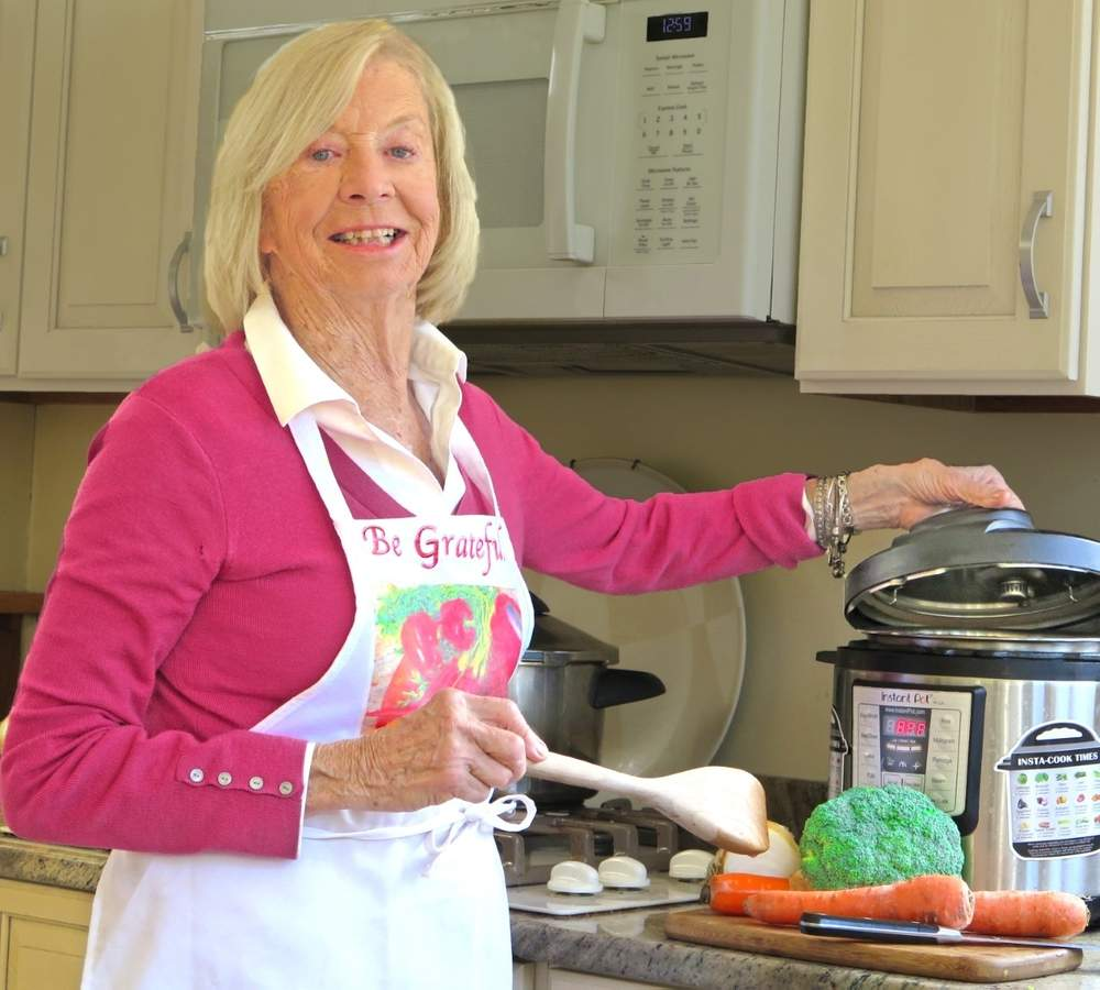 Guilford home cook and well-known Branford retired educator Virginia 'Ginny' Baltay has just unlocked the lid on her new cookbook, 'A Steamy Affair with a Pressure Cooker: Recipes, Stories & Saucy Suggestions.' She also plans to share her passion for pressure cooking during three Zoom-connected Shoreline Adult Education evening classes. Photo courtesy of Virginia Baltay
