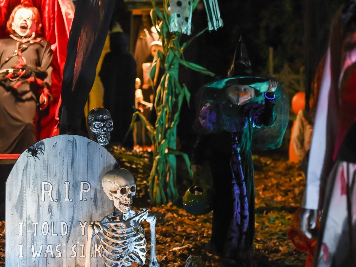 Terry and Doug Hathaway out did themselves this year with their popular Halloween display in their front yard at 9 Alden Drive, Clinton hoping to bring some thrills and chills to the kids and adults  this year during the pandemic. Vivienne Harder walked around the massive haunted display. Photo by Kelley Fryer/Harbor News