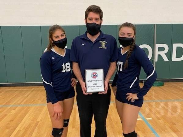 The East Haven girls' volleyball team earned the runner-up trophy in the SCC Division C Tournament this year. Pictured are senior captain Tori Heaphy, Head Coach Craig Brown, and senior captain Carly Cordova. Photo courtesy of Craig Brown
