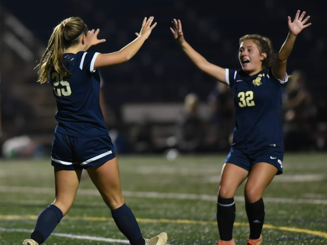 Senior Bella Pilato celebrates with sophomore Gianna Mendez after Pilato netted a goal during East Haven's 4-1 win versus Wilbur Cross in the first round of the SCC Division B Tournament on Nov. 9. Photo by Kelley Fryer/The Courier