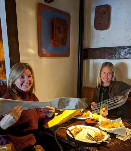 Old Saybrook Chamber of Commerce Great Restaurant Raffle boosters Jackie Root and Suzanne Sirico dig in at the Cuckoo's Nest. Photo by Meryl Moskowitz