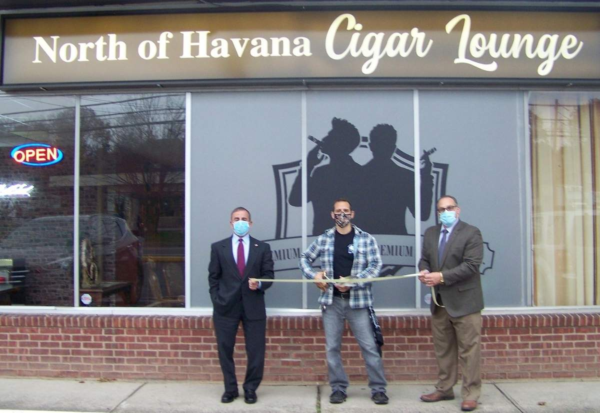 North of Havana co-owner Christopher Cassese (center) cuts the ribbon assisted by First Selectman Mike Freda (left) and Quinnipiac Chamber of Commerce Senior Director of Sales & Marketing Gary Ciarleglio. Photo courtesy of the Quinnipiac Chamber of Commerce