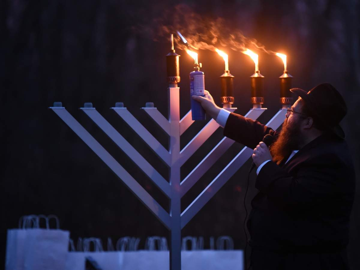 Chabad of the Shoreline held virtual celebrations for Chanukah every night except for Sunday night, the fourth night of Chanukah when they held a drive in menorah lighting in the parking lot of 2730 Boston Post Road, Guilford. Rabbi Yossi Yaffe lit the menorah. Photo by Kelley Fryer/The Courier