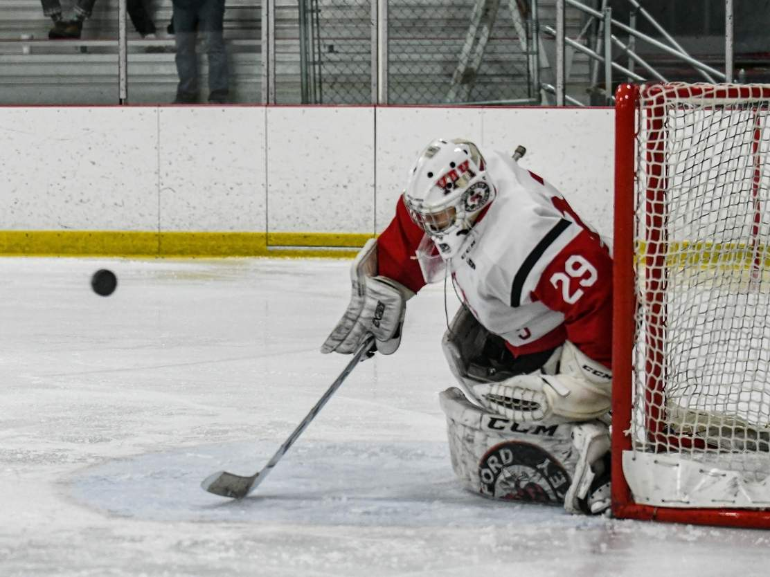 The CIAC has given approval for a winter sports season to take place in 2021. Pictured is Jared Yakimoff, a senior goalie on the Branford boys' ice hockey team. File photo by Susan Lambert/The Sound