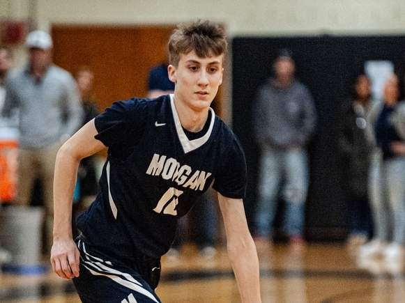 Senior captain Zach Johnson and the Morgan boys' basketball team picked up a pair of wins to jump out to a 2-0 start on the young season. Johnson scored 15 points in the Huskies' home win over East Hampton on Feb. 10. File photo by Susan Lambert/Harbor News