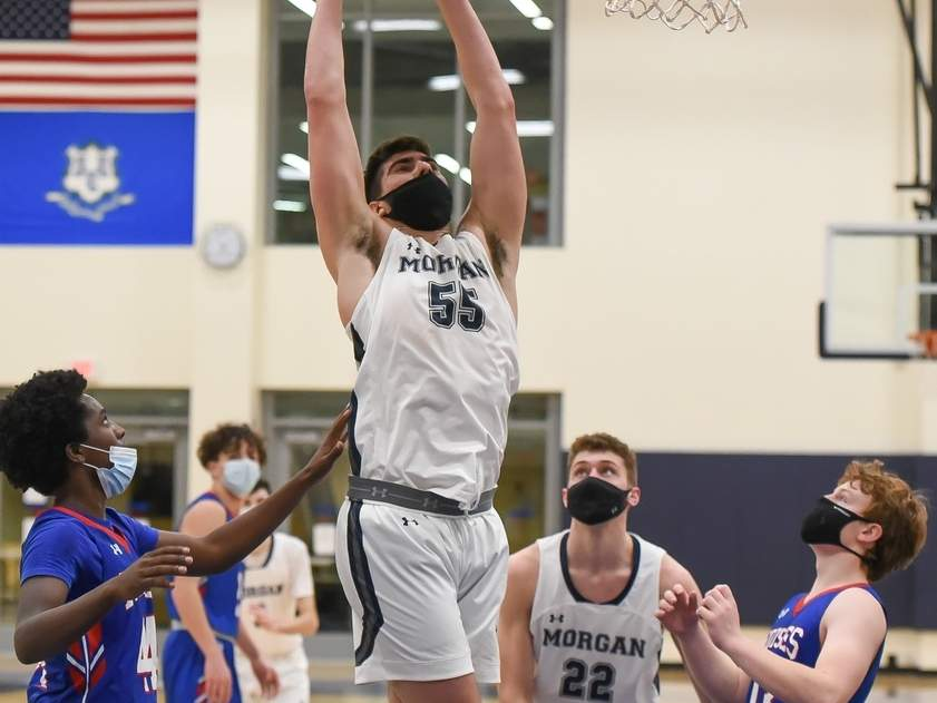 Senior captain Robbie Zirlis and the Morgan boys' basketball team continued their winning ways with two more wins to move to 8-0 last week. Zirlis scored 17 points in the Huskies' 70-49 win over Hale-Ray on March 4. Also pictured is Alex Fratamico.  Photo by Kelley Fryer/Harbor News