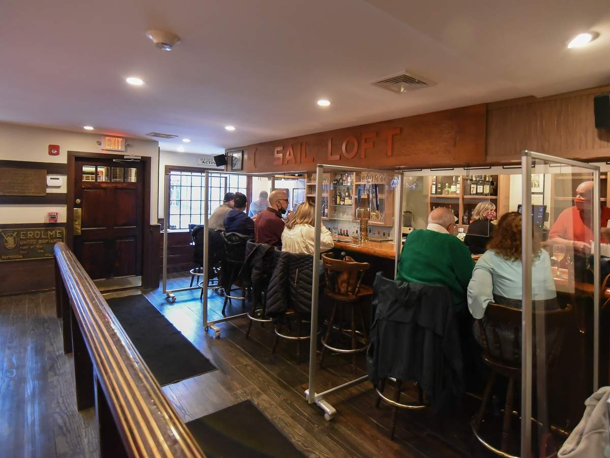 The Black Seal Restaurant re-opened Feb. 26 after being closed due to a January 2020 fire. The bar and dining room now have COVID prevention barriers set up. Photo by Kelley Fryer/The Courier