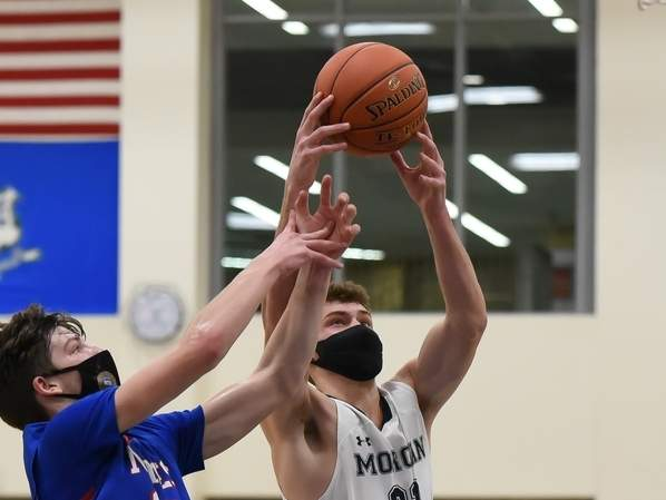 Junior Alex Fratamico and the Morgan boys' basketball team notched a pair of victories last week to move to a perfect 12-0 to close out the regular season. Fratamico has come on strong of late, tallying 20 points in the Huskies' 76-65 win over Portland on March 15, as well as 22 points in Morgan's 61-54 victory over Haddam-Killingworth on March 18. Photo by Kelley Fryer/Harbor News