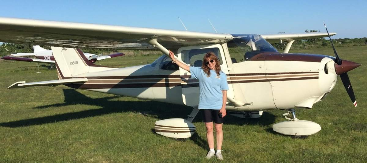 As an attorney and an instrument-rated small airplane pilot, Guilford resident Jenifer Sills Yoxall has been charting new territory as one of the few local attorneys familiar with drone laws, and hopes to help others navigate some of the more important aspects of drone operation. She's shown here with her plane on Block Island, Rhode Island during a family trip. Photo courtesy of Jennifer Sills Yoxall