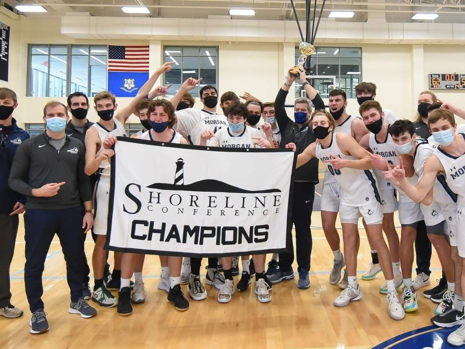 The Morgan boys' basketball squad claimed the Shoreline Conference Tournament title after defeating Valley Regional 62-54 in the final on March 27. The Huskies also claimed a perfect record on the year finishing with a 15-0 mark. Photo by Kelley Fryer/Harbor News