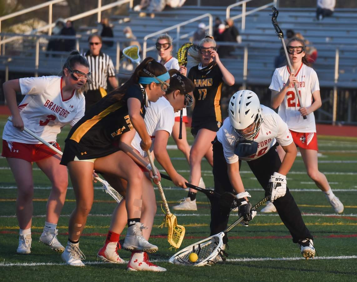 Branford Girls Lacrosse lost 4-16 to Daniel Hand at Home. Jocelyn Smestad  (3), Jennifer Antell  (6), Ellena Galdenzi (40), Catherine Duffy (21) Photo by Kelley Fryer/The Sound