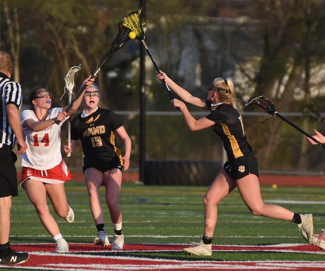 Daniel Hand Girls Lacrosse beat Branford 17-4 at Branford High School. Lydia Doraz (19), Karleigh Kokoruda  (17) Photo by Kelley Fryer/The Source