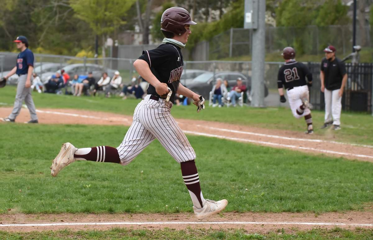 North Haven Boys Baseball beat Foran 3-1 at the Robert E.  DeMayo Field, North Haven.Steven Vincent (2) heads home as Tyler Harger  (21)  runs to first base.  Photo by Kelley Fryer/The Courier