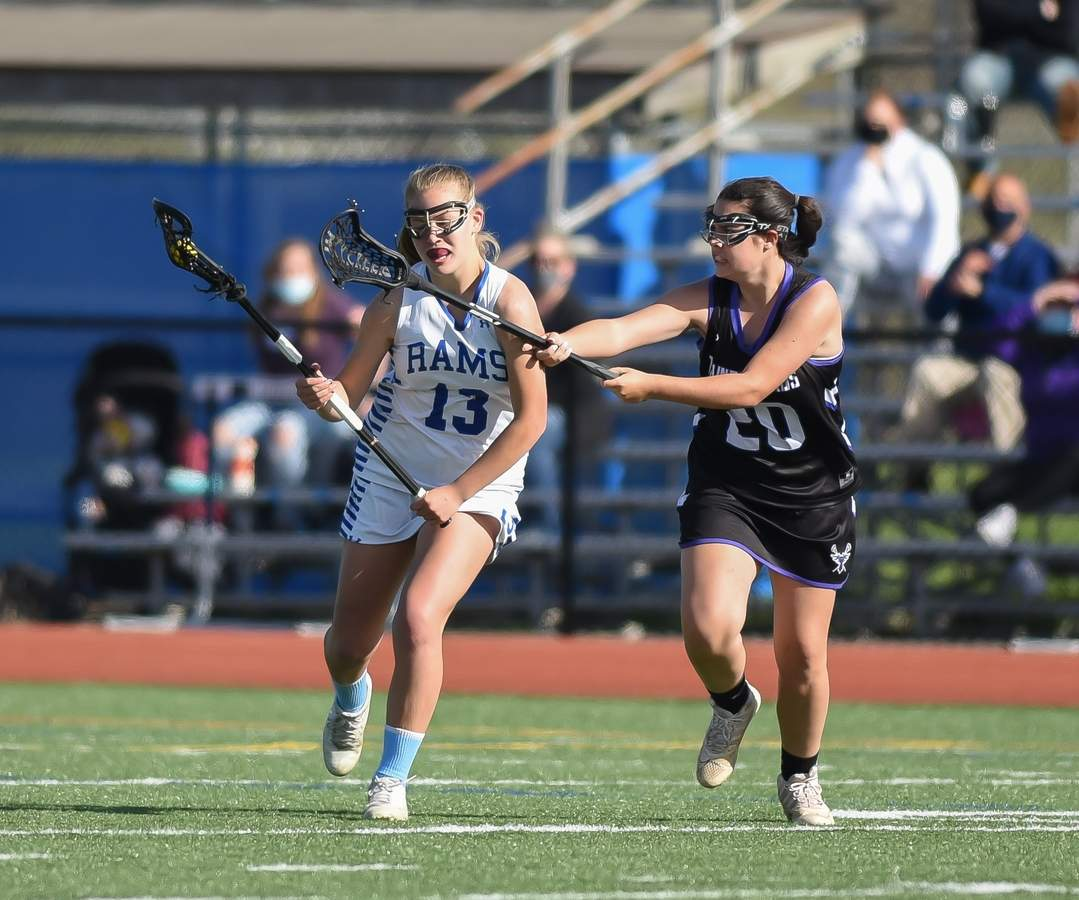 North Branford Girls Lacrosse lost 11-13 to Old Saybrook at Old Saybrook High School. Grace Marra (20) Photo by Kelley Fryer/The Sound