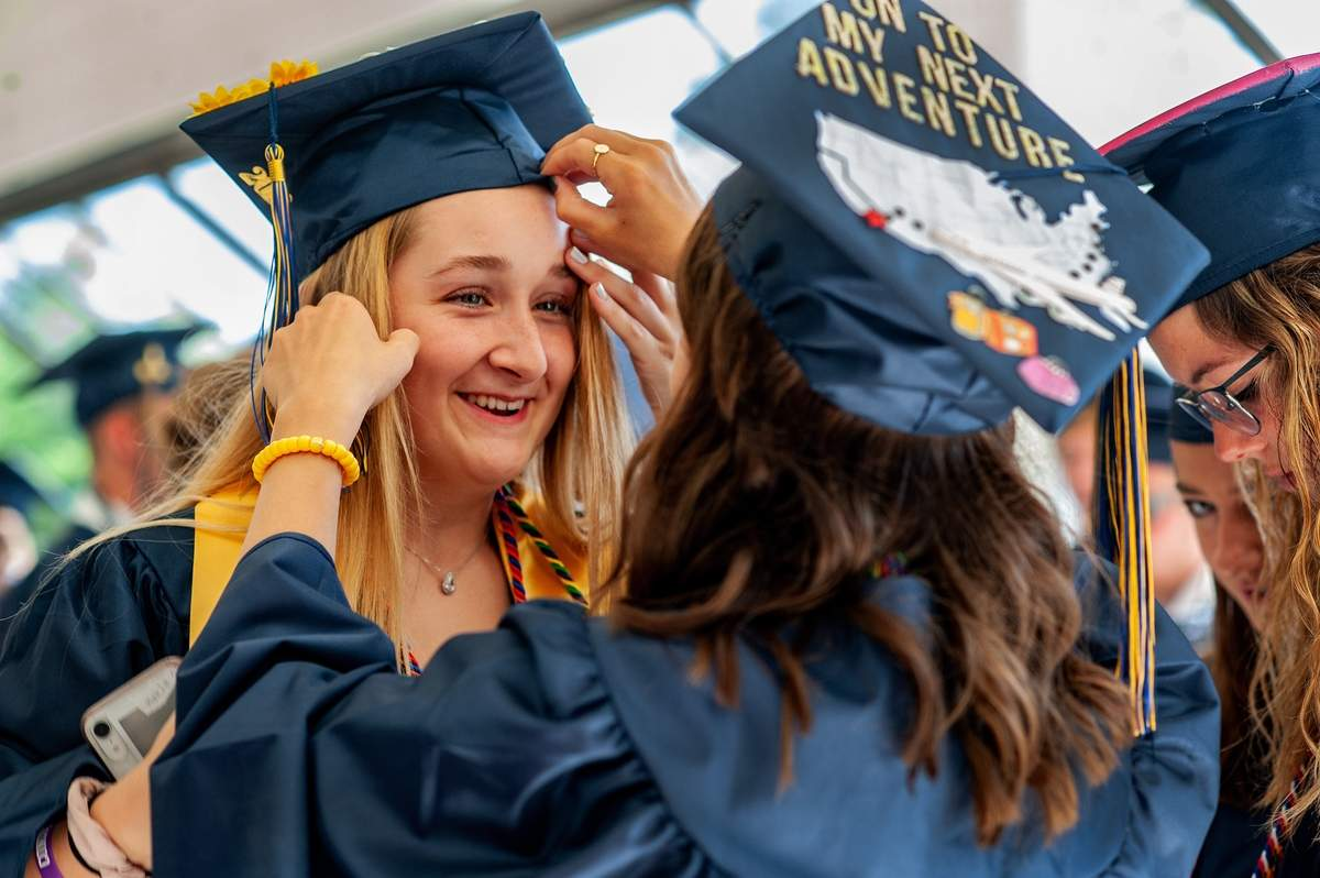 Haddam Killingworth High School held their graduation for the class of  2019 on Tuesday June 11th.  Mikayla Nuhn has help with her cap from fellow grauate Erin Figurelli.   Photo by Susan Lambert/The Source