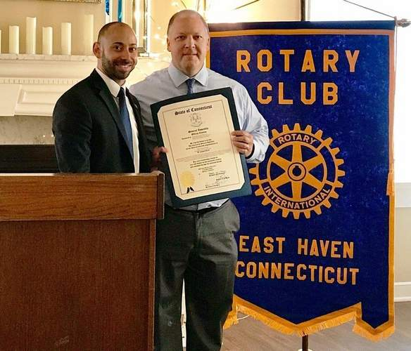 State Representative Joseph Zullo (R-99) presents a Connecticut state legislative official citation to East Haven Police Officer Dave Torello, who retired from the department after 26 years. Photo courtesy of Frank Gentilesco, Jr.