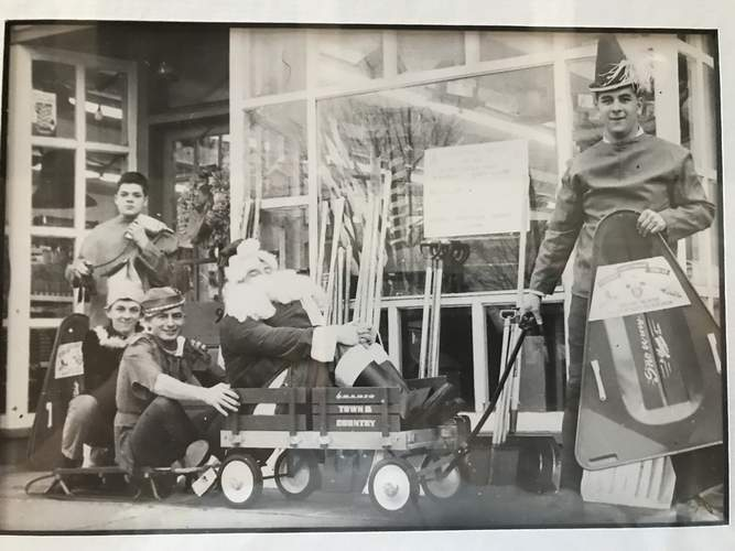 The Page Hardware crew has placed decorative displays along the Boston Street sidewalk since the early days. Photo courtesy of Andrew Page
