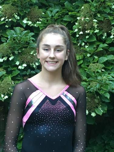 Megan Cafferty, a Clinton resident who competes at Flip-Flop Gymnastics in Deep River, finished in first place for the all-around as a member of Flip-Flop's Xcel Platinum team at the State Championship meet. Photo courtesy of Megan Cafferty