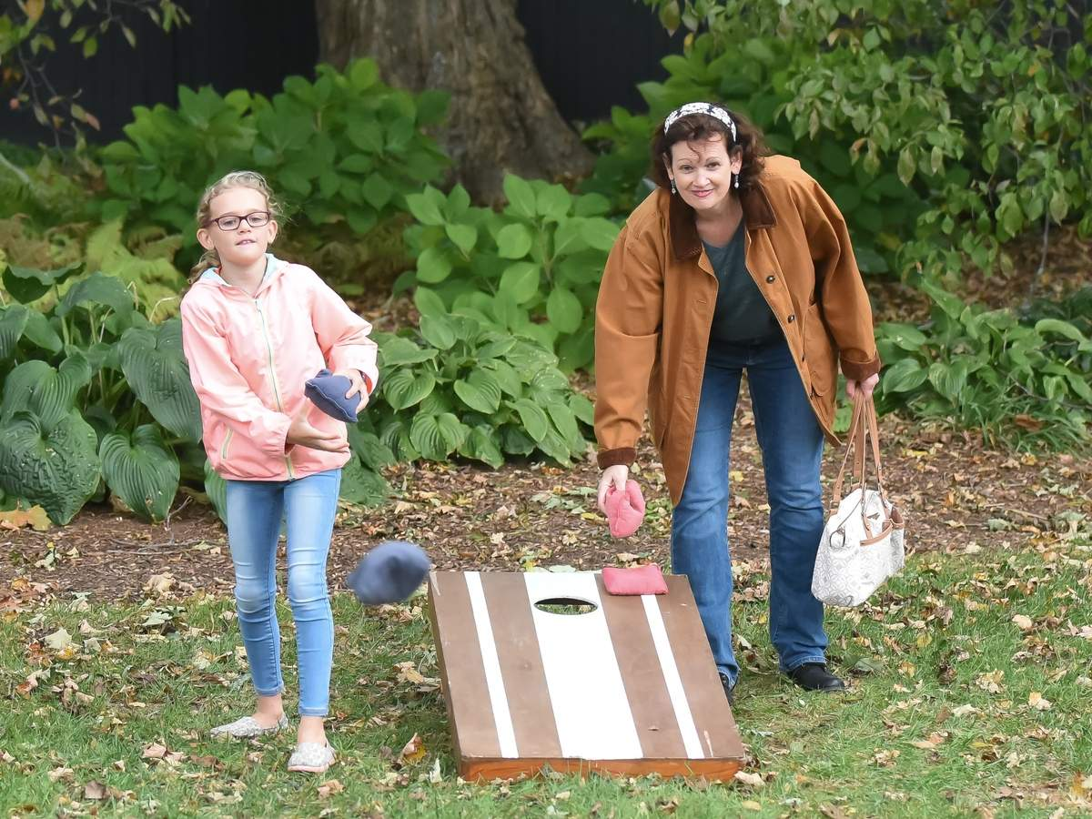 The Essex Scarecrow's were out along Main St in Essex Village with fun activities for all ages for the Essex Scarecrow Festival. A friendly game of Cornhole with Kayleigh Cornett and Sharon Lewis. Photo by Kelley Fryer/The Courier