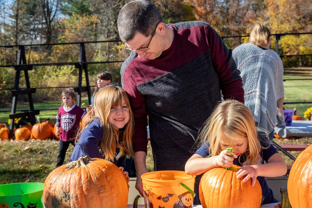 Families and friends took part in the 7th Annual Pumpkin Carving Party at Parmelee Farm on Saturday, October 26, 2019. Pumpkins were provided to be carved, displayed at the farm, and then lit up in the evenings leading to Halloween. Face painting and refreshments were available, as well. The event was hosted by the Middlesex Chamber of Commerce, Parmelee Farm, and the Killingworth Lions. Emma, Tom, and Madeline Szwejkowski work on emptying their pumpkins. Photo by Meglin Bodner/The Source