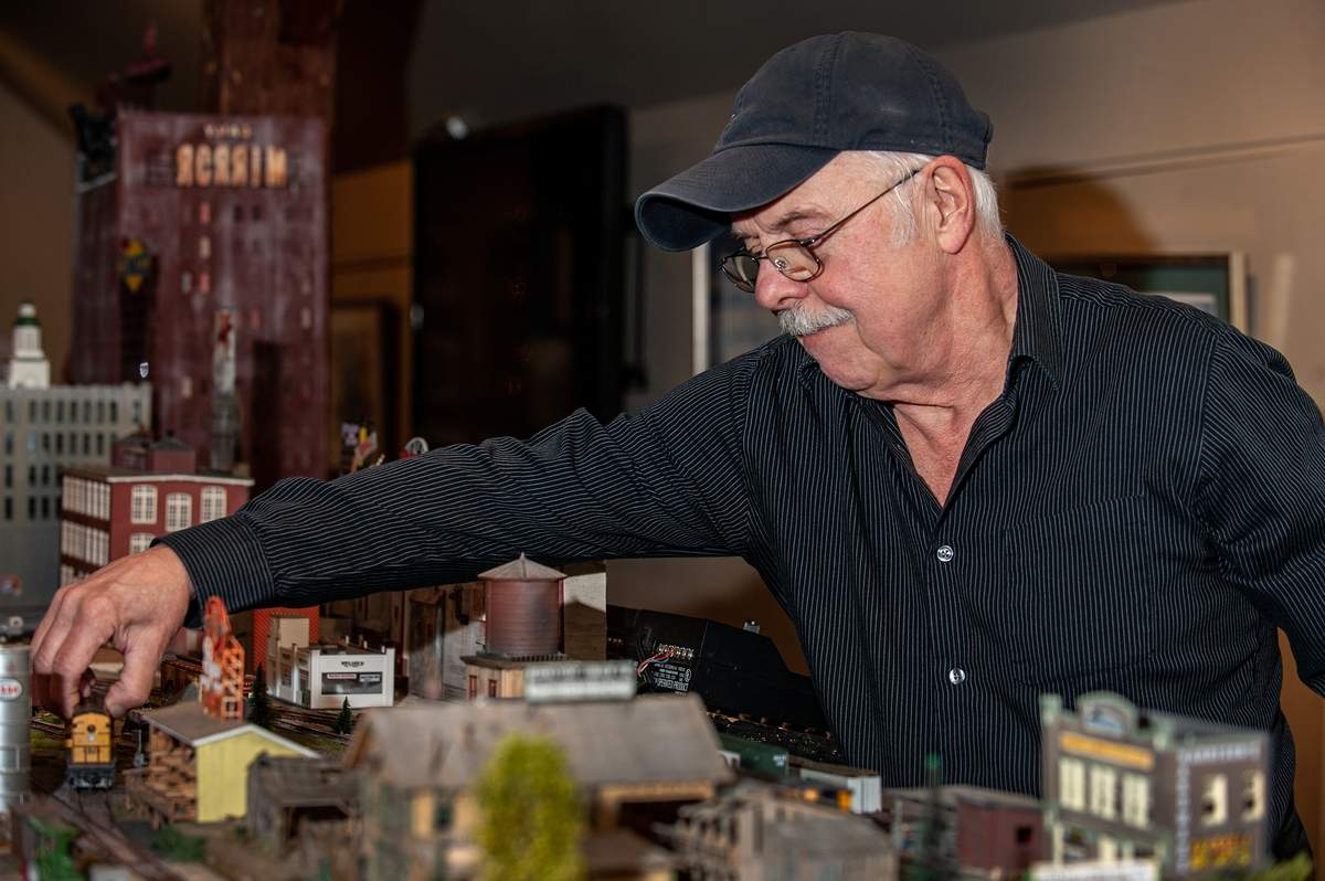 Artist and train enthusiast Steve Cryan at work on his train layout at the Connecticut River Museum. For the past 26 years his intricate miniature world of trains signals the start of the holiday season at the museum. The exhibit features an intricate 26ft model layout, a childrenþÄôs interactive layout, original art by Cryan, model trains and a discovery game. Collecting trains since he was a child Cryan worked on the railroad while serving in the army.  The train exhibit opens November 27th and runs through mid-February. For more information go to ctrivermuseum.org/exhibition.    Photo by Susan Lambert/The Courier