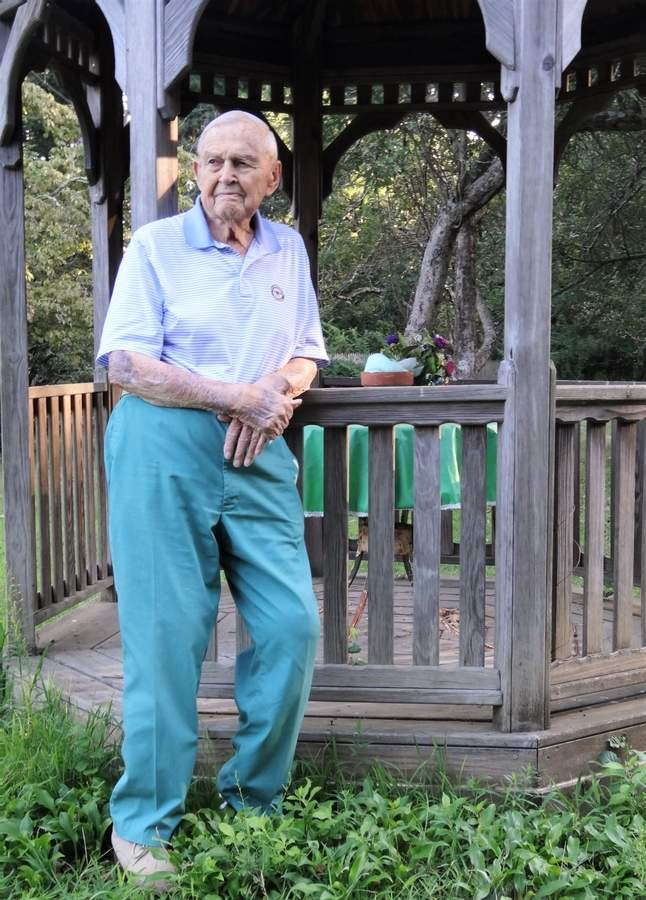 Adrian Bassett is a 100-year old Madison resident who served as chief of the Madison Fire Department. Adie, as everyone calls him, still does his own grocery shopping, mows his own yard, and recalls world events with vivid detail. Photo courtesy of Clay Bassett