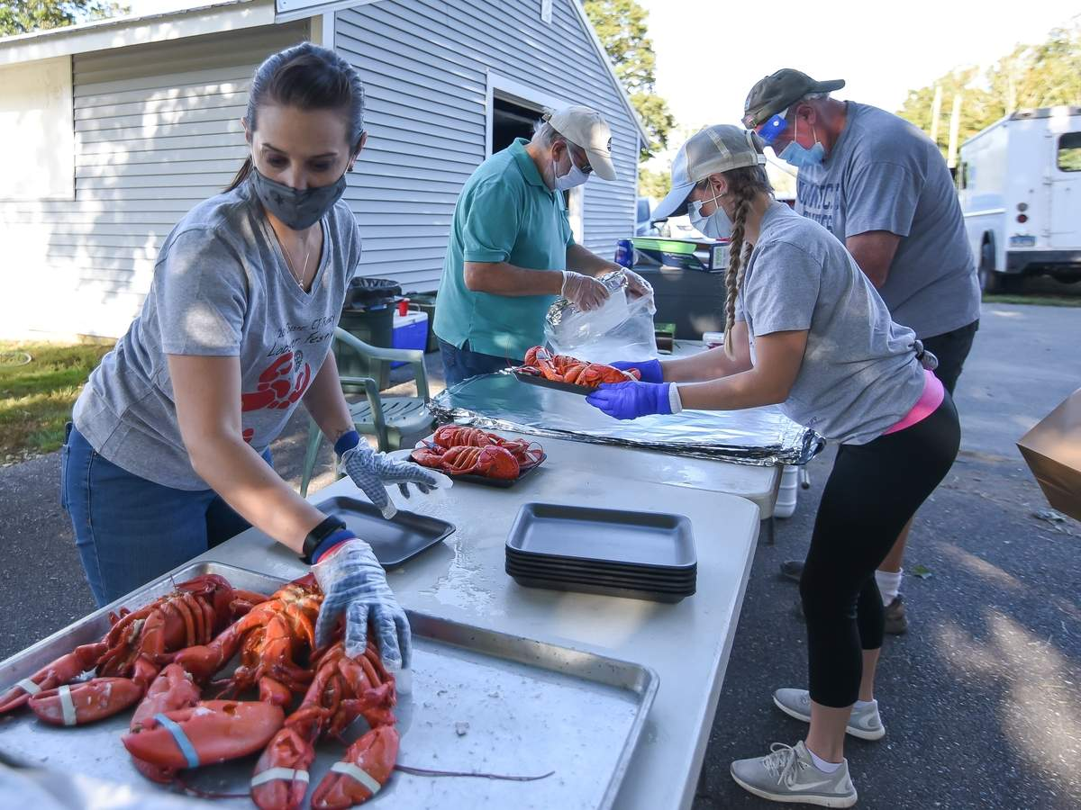 The Chester Rotary Club held a Take-out Lobster Dinner Fundraiser at the Chester Fairgrounds on Saturday night, with 2 hot lobster dinners,corn on the cob, baked potato, butter rolls and coleslaw,  packed up to go for a drive through pick up. Over 200 meals were ordered. Angela Jones, Greg Jones, Kaitlin Sarsfield and Ted Taigen pack up the lobsters.  Photo by Kelley Fryer/The Courier