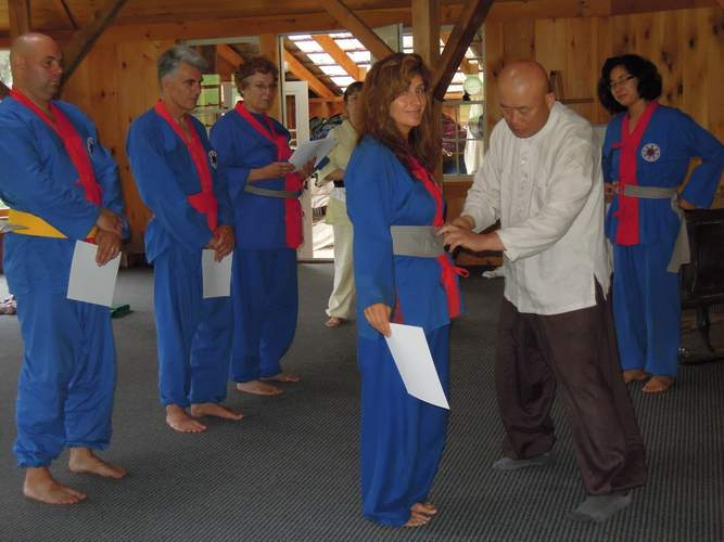 Christine Ucich of One World Wellness in East Haven gets her grey belt in 2011 at the SunDo Retreat Center in Vermont. She attained black belt in 2013 when she traveled to South Korea for the annual black belt ceremony in Seoul. All SunDo practitioners in the West must go to this ceremony for their black belt. Photo courtesy of One World Wellness