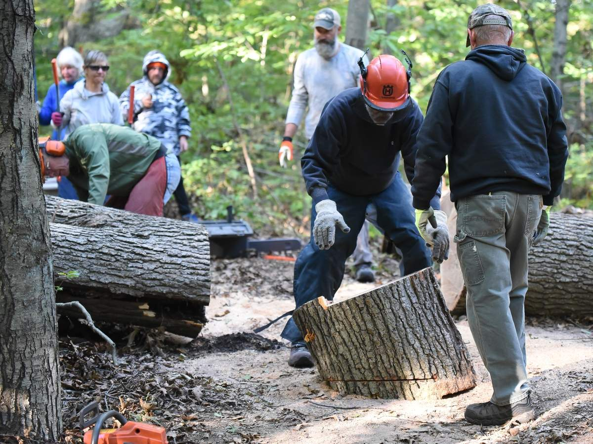 PeterþÄôs Rock Association put out a call to help clean up the downed trees on Saturday 19th from 8:30am to noon.  The group set out to clear the downed trees blocking parts of the red trail.  Photo by Kelley Fryer/The Courier