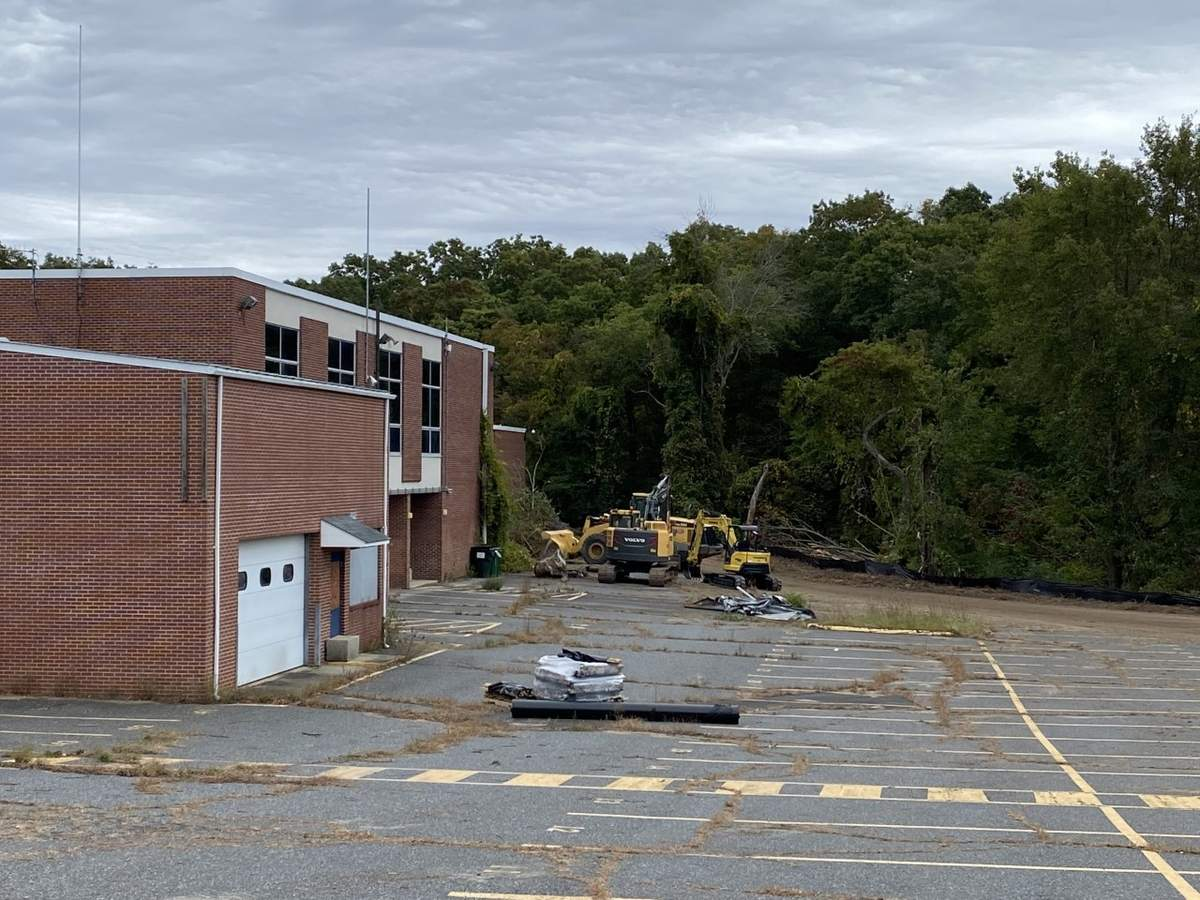 In advance of a closing that occurred today, Oct. 5, heavy equipment has been allowed to stage on the site of the old Morgan School. Photo by Eric O'Connell/Harbor News